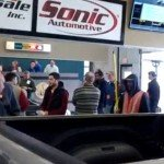 People attending a car auction