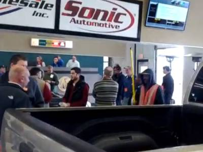 People attending a repossessed cars auction